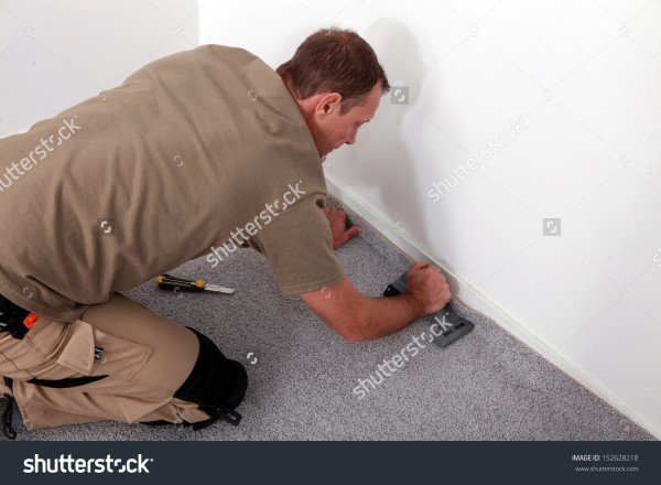 fitting-stock-photo-carpet-fitter-152628218